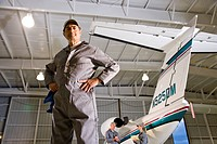 Airplane mechanics in hangar working on private jet
