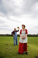 Senior couple standing in green field