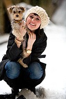 Young woman hugging a dog