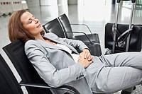 Businesswoman napping in airport terminal