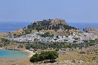 View towards the Castle of the Knights of St John and the Acropolis, Lindos, Rhodes, Greece, Europe