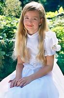 Girl wearing communion dress