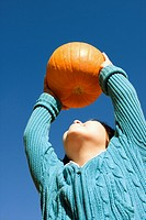 young girl finds the perfect pumpkin