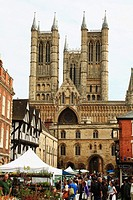 Crowded street and at the background the Lincoln Cathedral, Lincolnshire, the Midlands, UK