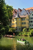Pedal boat and punt on the Neckar river in front of the Hoelderlinturm tower, Neckarfront, Tuebingen, Baden-Wuerttemberg, Germany, Europe