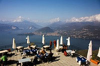 Restaurant with panoramic view over lake Maggiore and Alps from Sasso del Ferro mount, Laveno, Varese, Italy, Europe