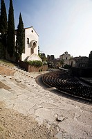 Antique Romanic theatre with seats and church behind, Verona, Veneto, Italy, Europe