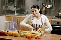 Woman peeling pears