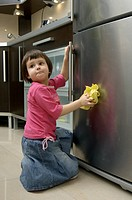 Girl cleaning fridge
