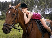 Girl sitting on the horse