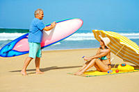 Active senior couple enjoying their holiday on a beach