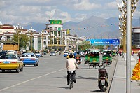 Main street with VW Santana taxis, rickshaws, China Post, Lhasa, Himalayas, Tibet Autonomous Region, People's Republic of China, Asia