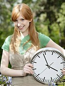 Girl with a clock in her hands.