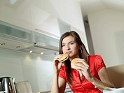 Woman eating hamburgers.