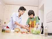 Mother with son preparing salad