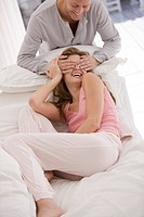 Man covering eyes of a woman from behind