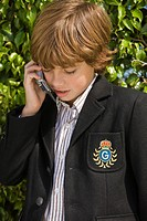 Schoolboy talking on a mobile phone
