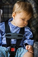 Baby boy sleeping in a baby seat (thumbnail)