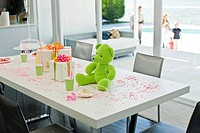 Teddy bear and birthday presents on a table