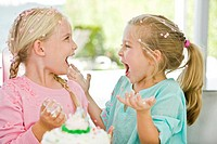 Two girls enjoying a birthday party