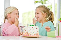 Two girls eating birthday cake