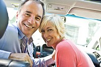 Couple in a car and smiling