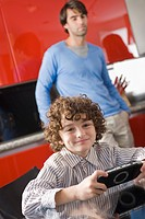 Portrait of a boy holding a video game