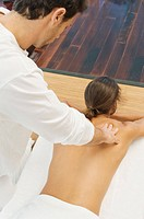 Man receiving a back massage from a massage therapist (thumbnail)