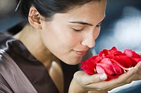 Woman smelling rose flowers