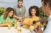 Friends enjoying beer and music on vacations