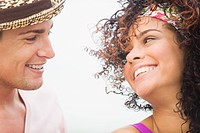 Close_up of a couple smiling at each other