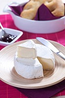 Wedge of fresh creamy cheese served with marmelade