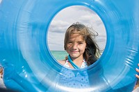 Girl looking through an inflatable ring