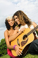 Couple playing a guitar