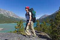 Young woman hiking, backpacking, hiker with backpack, historic Chilkoot Trail, Chilkoot Pass, Lake Bennett behind, Yukon Territory, British Columbia, ...