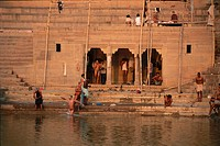 Photograph of several Indian men and women bathing in Ganges river