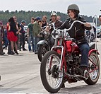 Young woman on an old motorcycle at the Road Runner Race 61 in Finowfurt, Brandenburg, Germany, Europe