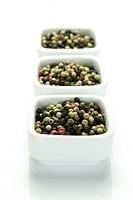 A close up shot of mixed pepper corns mixed together
