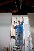 Volunteer from the United Methodist NOMADS group repair housing damaged in the 2008 Iowa flood, the NOMADS are retirees who volunteer their services f...