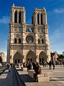 Tourists outside Notre Dame Cathedral, Paris, France, Europe