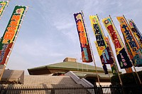 Main sumo stadium at Ryogoku in central Tokyo with traditional banners flying during a competition
