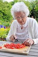 Senior woman preparing a salad