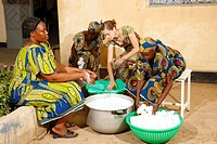 Women washing bottles, yogurt production at a dairy, Maroua, Cameroon, Africa