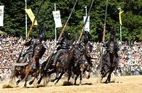 Four black knights riding horses, Knights' Tournament in Kaltenberg, Upper Bavaria, Bavaria, Germany, Europe
