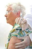 Elderly woman being vaccinated