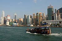 Excursion boat, wood junk against the skyline of Hong Kong Central, Hong Kong, China, Asia