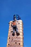 Boy climbing a climbing wall