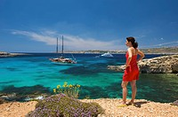 Woman looking on the Blue Lagoon of Comino, Malta, Europe