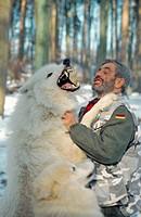 arctic wolf, tundra wolf Canis lupus albus, wolf scientist Werner Freund, keen welcoming in snow, Germany, Saarland, Merzig