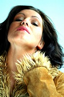 young darkhaired woman wearing fur coat